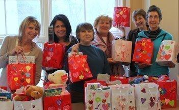 for West - 26wepeople - Members and guests of the Sudbury Wayland Lincoln Domestic Violence Roundtable recently distributed 75 ValentineÕs Day gift bags to adults and children in local shelters. (Handout)